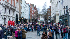 Crowds watching Covent Garden busker (1) - London UK Stock Footage