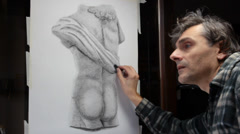 Artist at work on classic greek torso Stock Footage