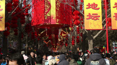 People visit temple fair in Ditan Park during Chinese Spring Festival Stock Footage