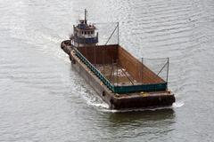 Garbage transport ship - stock photo
