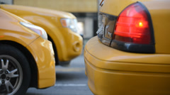 NYC Taxi Cabs in Traffic Slow Closeup Stock Footage