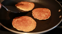 Checking if pancakes are cooked Stock Footage