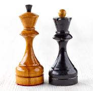 Two old wooden chess pieces Stock Photos