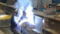 Steel worker welding I-Beam Stock Footage