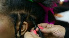 Braiding Hair of a young girl Stock Footage
