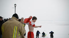 Man Jumping Into Icy Water With Canada Flag Stock Footage