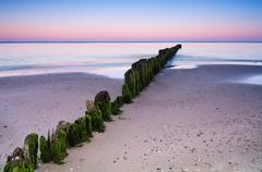 Breakwater sunset Stock Photos