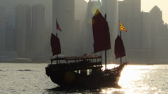 Asia China Hong Kong Chinese fishing boat Junk skyline metropolis - stock footage