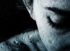 Woman and drops of rain Stock Photos
