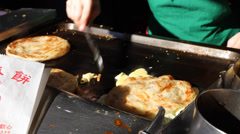 A famous pancake snack on yongkang street Stock Footage