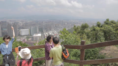Pan of Taipei 101 Elephant Mountains first popular viewpoint Stock Footage
