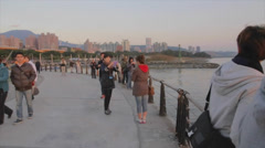 A beautiful golden sunset at Taipei Tamsui waterfront pan with people Stock Footage