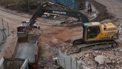 Demolition, excavator filling truck Stock Footage