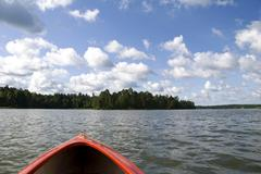 View from red kayak at Nidzkie lake - stock photo