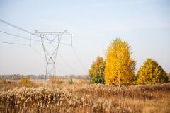Power grid pylon or electric power transmission - stock photo