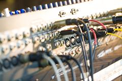 Close-up of guitar amplifier with jack cable Stock Photos