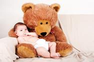 Stock Photo of Baby with bear