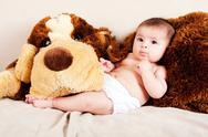 Stock Photo of Baby with dog