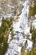 icy waterfall up in the mountains - stock photo