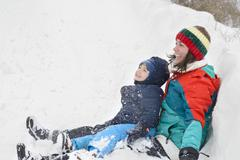 mother and son in wintertime - stock photo