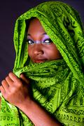 Shy African woman with scarf - stock photo