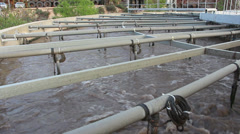 Low angle shot of wastewater treatment tank Stock Footage