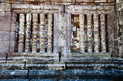 craved stone at wat phu si at jam pa sak, laos - stock photo