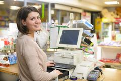 Happy cashier Stock Photos
