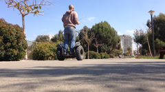 Segway ride in the park Stock Footage