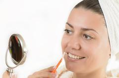 Woman using an interdental brush Stock Photos