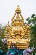 bodhisattva statue with dragon - stock photo