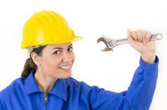 Woman holding adjustable wrench Stock Photos