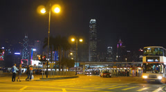Asia China Hong Kong skyline Tsim Sha Tsui Star ferry bus station night Stock Footage