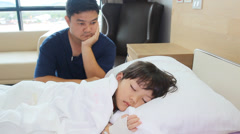 Father look after little sick girl in the hospital - stock footage