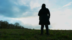 Depressed woman in middle of countryside (dolly) Stock Footage