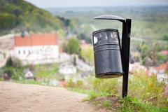 rubbish bin on the hill and blurred dale view - stock photo