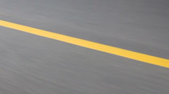 Speed background – asphalt road and yellow line. Blurred  motion Stock Footage