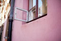 small ventilation window and pink wall in Warsaw - stock photo