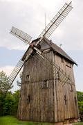 old wood windmill with sails in Poland - stock photo