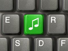 Computer keyboard with music key - stock photo
