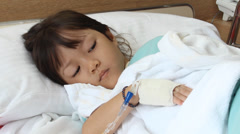 little girl in the hospital - stock footage