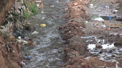 Dirty open sewer canal in Bhubaneswar, Odisha, India. Nature  pollution Stock Footage