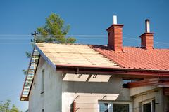 roof renovation exposed timber rafter and tiles - stock photo