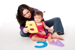 Baby learning alphabet ABC Stock Photos