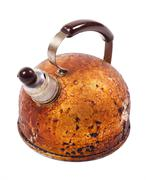 Old brown worned kettle and whistle on spout Stock Photos