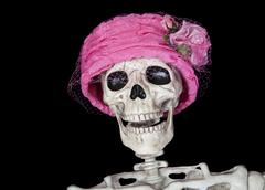 skeleton in vintage pink hat - stock photo