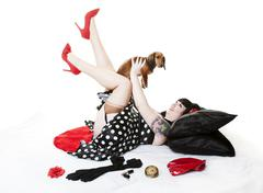 Pinup with puppy Stock Photos