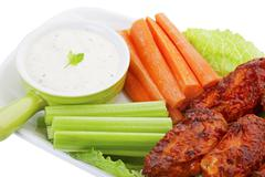Hot wings with vegies and dip Stock Photos