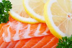 Salmon with lemon slices Stock Photos
