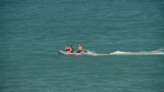 Inflatable boat travelling across sea Stock Footage